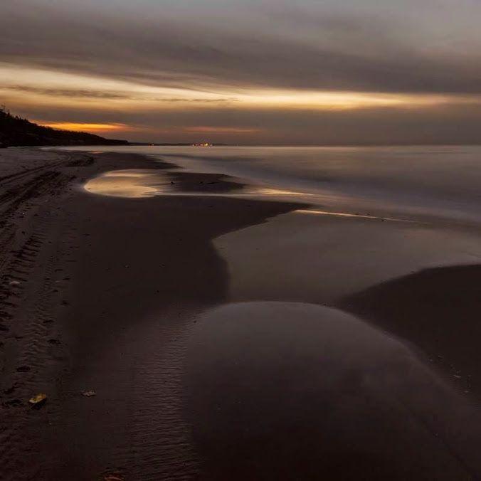 Dariusz Klimczak  Beach Poddąbie, in a light Ustki.
