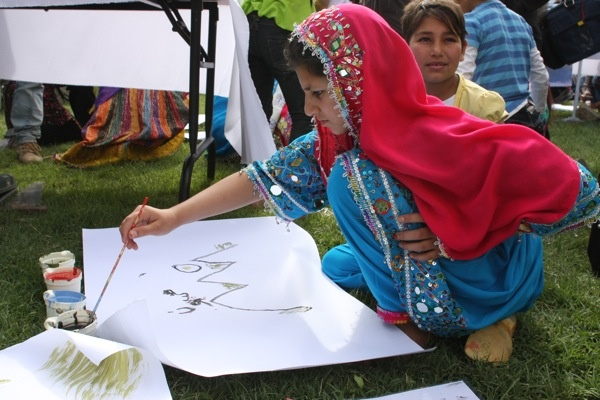 A girl paints at the Afghan Youth Voices Festival event in 2011.