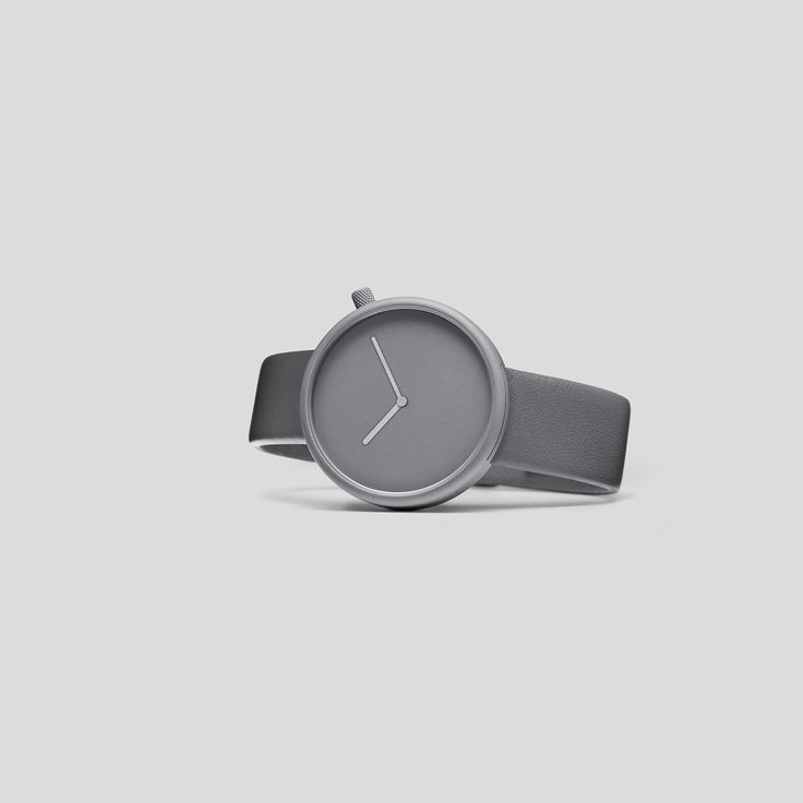 STONE-GREY, TITANIUM-COATED STEEL ON GREY ITALIAN LEATHER  Following the slightly asymmetric Pebble and the clean and contemporary Facette, the circular, minimalist Ore watch reduces timekeeping to its pure essence.