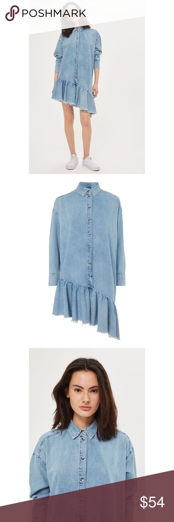 """{Topshop} MOTO Denim Asymmetric Shirt Dress Re-work your denim wardrobe with our innovative denim shirt dress. In a light wash, this long sleeve style features tortoiseshell button closures through the front, buttoned cuffs and a stand-out asymmetric frill hem. Style it with your favourite lifestyle trainers for casual days. 100% Cotton. Machine wash. Full fit. Approx length: 32"""" - 38"""". Location: B1 Topshop Dresses Asymmetrical"""