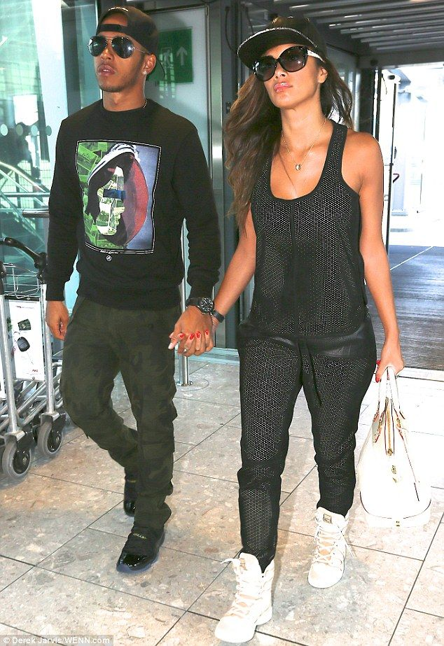 Cool customers: Lewis Hamilton and Nicole Scherzinger were spotted hand-in-hand after arriving at Heathrow airport on Sunday