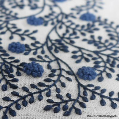 Hand embroidered cloth with delicate blue flowers by Yumiko Higuchi