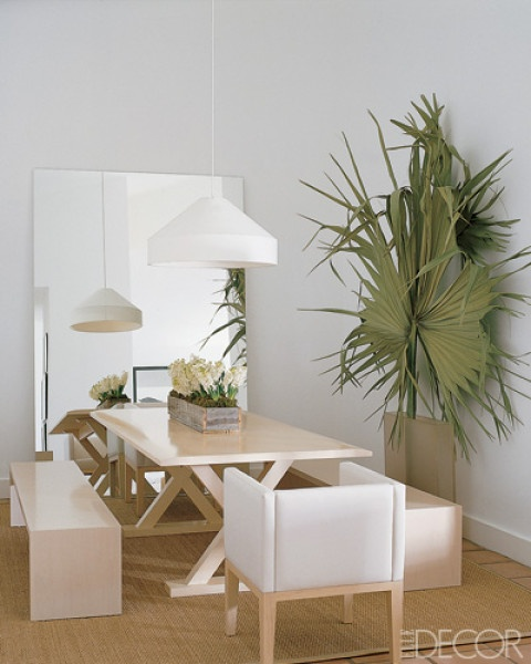 Kelly Klein's Florida apartment, the benches are custom made, and the Sucre Rosa chairs, Courier table, and Accueil pendant lamp are all by Christian Liaigre.