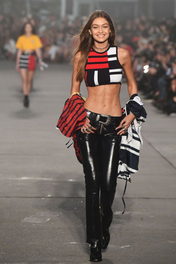 Gigi Hadid's Abs Were the Main Attraction at the Extravagant Tommy x Gigi Show | Fashion, Fashion trends magazine, Gigi hadid abs
