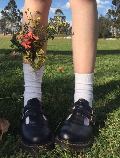 How wild flowers whisper where she walks