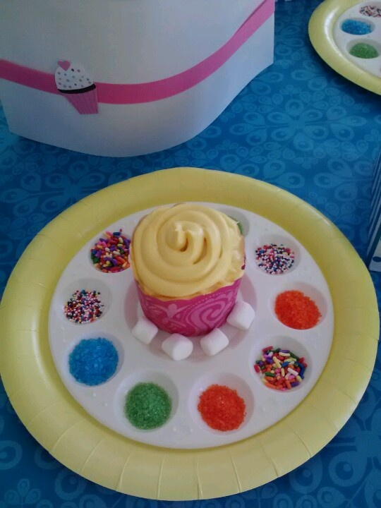 Use a paint tray w toppings for each child to decorate their own cupcake. Love this to combine with 'art' party!!