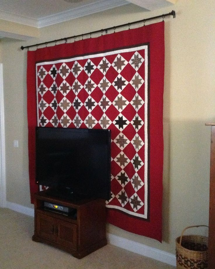 """From """"Olde Green Cupboard Designs,"""" look at the clever way they hang quilts so they can easily switch them out. No need for a hanging sleeve or loops on each quilt, either."""