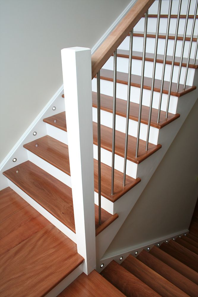 A staircase with timber treads painted stringers risers for Painted stair treads