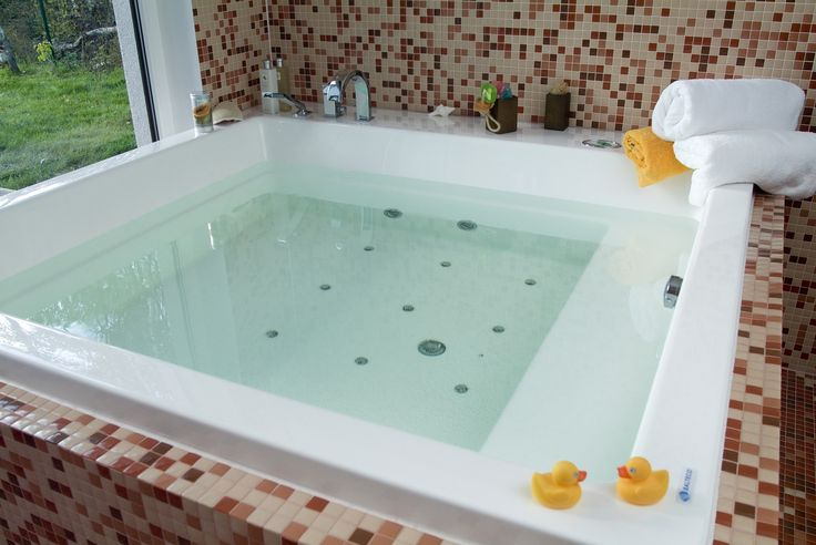Product Info The massive Lacus Drop-In tub has been created with a blend of traditional styling and square design, making it suitable for any spacious, high end bathroom project. With comfortable buil
