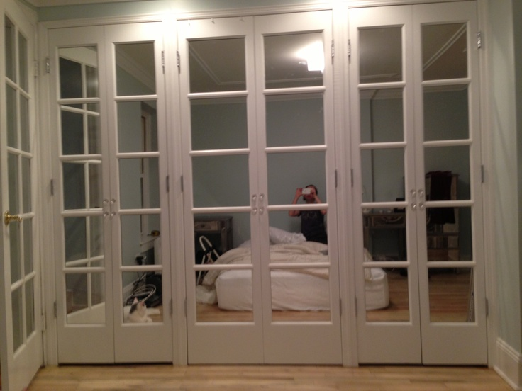 Mirrored French doors in bedroom