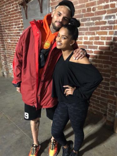 Chris Brown pairs the oversized Shell jacket by Balenciaga with Nike Air Max sneakers