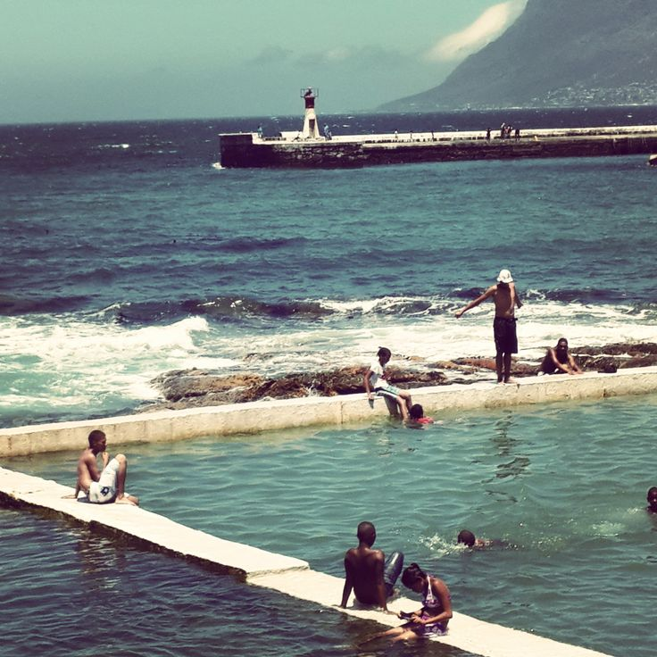 Swimmers at St.James Tidal pool from the Brass Bell top deck. Cape Town. south Africa. (photo: Nicci Martin)