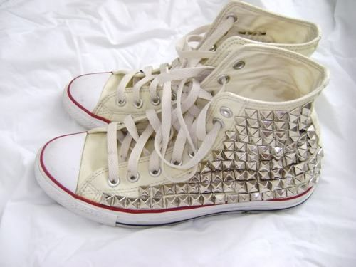 studded white converse