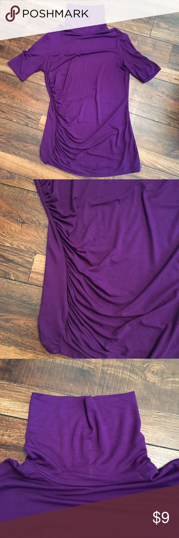 NY&Co Purple Short Sleeve Turtleneck Top NY&Co Purple Short Sleeve Turtleneck Top. Size medium. 95% rayon, 5% spandex. 18 inch across chest, 28 inch length, 5 inch sleeve. Perfect stretch turtleneck with side ruched detail. New York & Company Tops