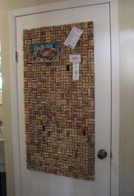 Wine cork bulletin board in old door for the home for Old home bulletin board