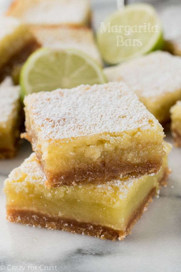The BEST Margarita Bars! It's an easy lime bar recipe with a hint of tequila and a graham cracker crust!