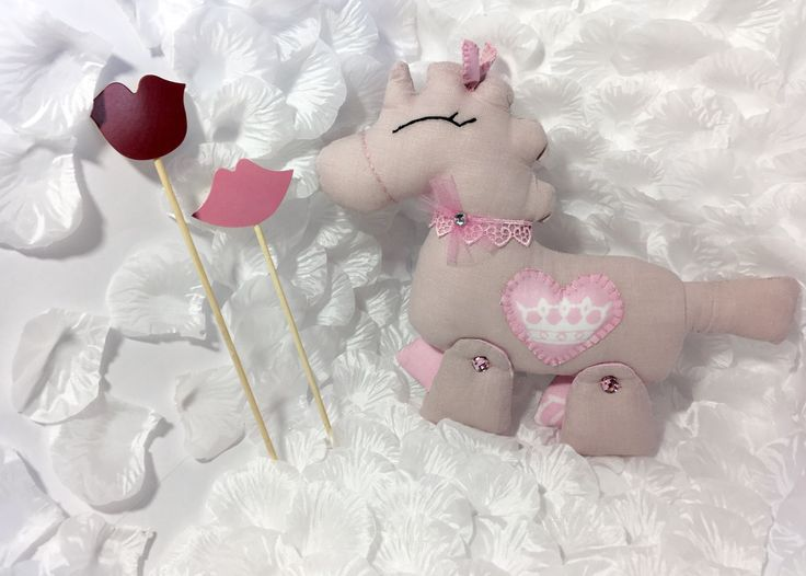 Pale pink linen unicorn toy with crystals and heart details