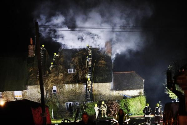 Thatched cottage on fire in Thrupp, near Kidlington