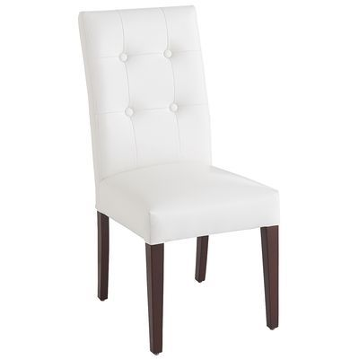 Our take on the classic Parsons Chair is built of birch, then covered in foam padding and hand-upholstered in smooth, durable bonded leather. Transitional button tufting enhances the iconic, contemporary profile. Tapered legs have an espresso finish. A Pier 1 exclusive.