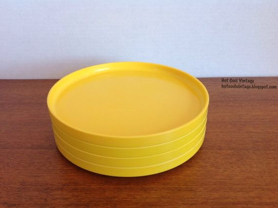 Collection of Vintage Heller Vignelli melamine plates, bowls, cups for outdoor dining in yellow, green, white, and blue
