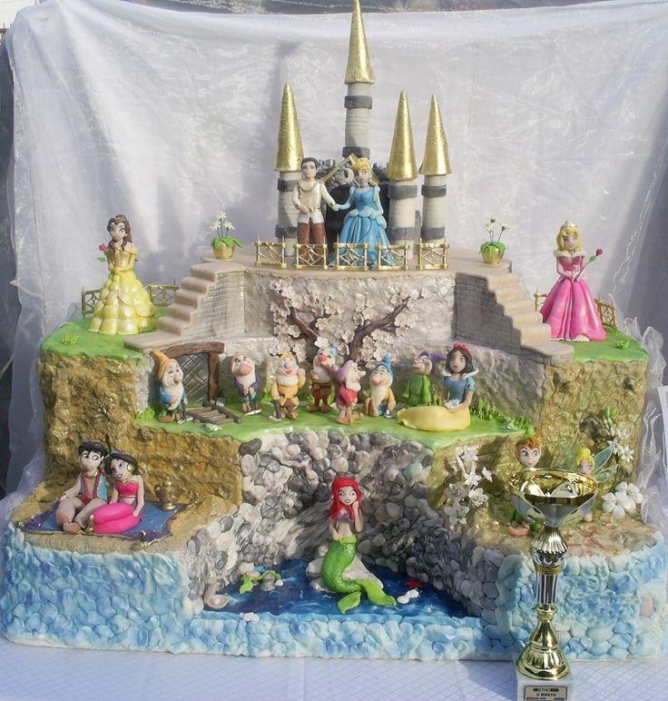 Disney Princess cake. Love how it incorporates every fairytale :)