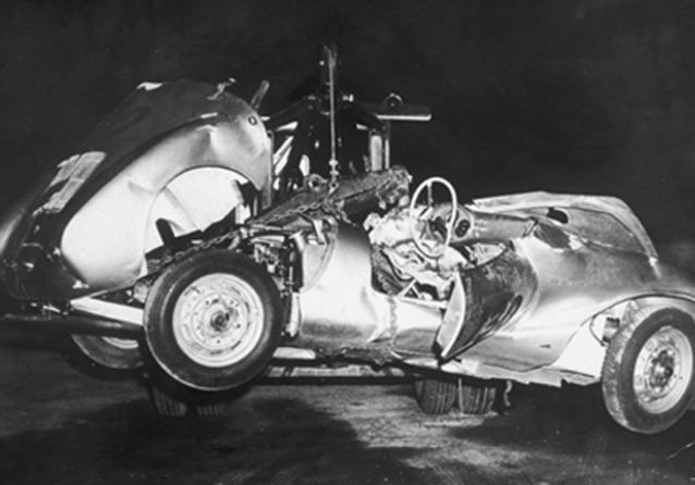 Tragedy: The wreck of Dean's car is removed from the scene of the crash in which the star was killed