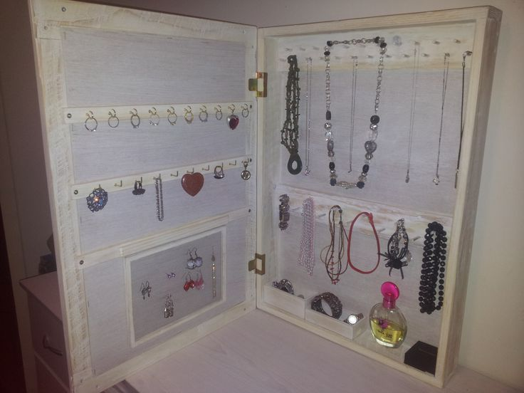 Wall mount Jewelry Storage Mirror. Made from up cycled Pallet