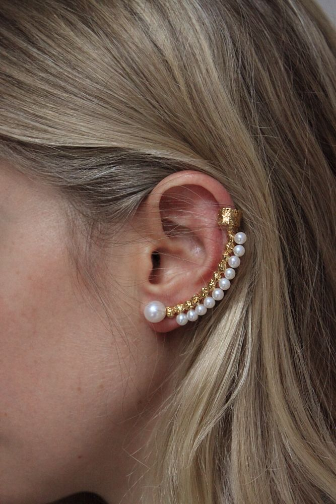 A custom 'Pepper Pearl' Cuff Earring by Lucy Folk.
