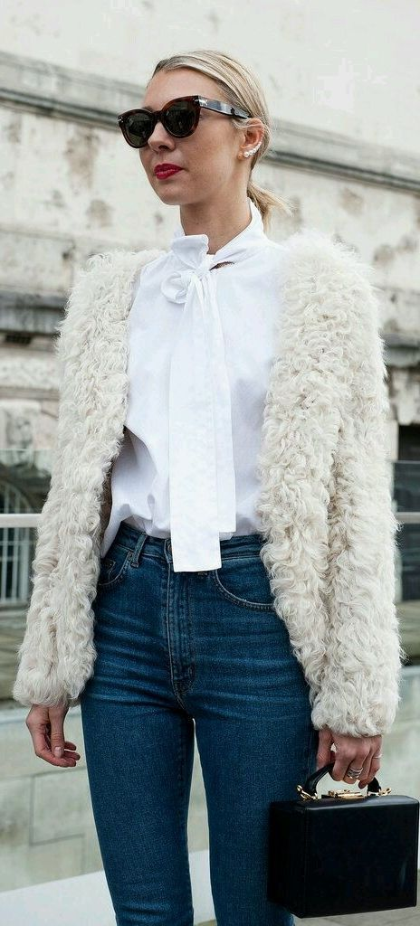 London Fashion Week street style: Faux Fur and High Waisted Denim plus a tie collar shirt, feminine sunglasses and a structured purse
