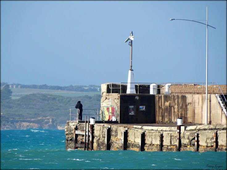 An enthusiastic fisherman at the Warrnambool breakwater today during a rare burst of sunshine. (Look how high the tide is no swimming today!) #destinationwarrnambool #warrnamboolbreakwater by tracey_kruger