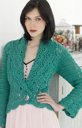 Beautiful crochet cardigan. I love that the cardigan comes down low to show off pretty details of any blouse you are wearing instead of covering it up. The lacy-ness of this cardigan is very nice too. I don't like the button though.