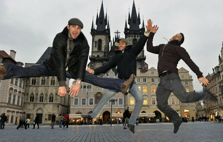 Mark Stuart, Patrice Bergeron, and Andrew Ference of the Boston Bruins in the town square of Prague, Czech Republic. Jumping like deranged people.