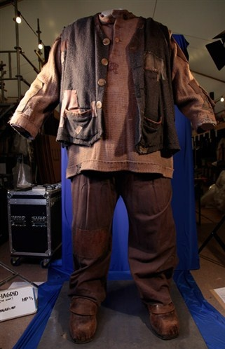 To help with the illusion of the actor who plays Hagrid being a giant, all buttons, obvious stitching and bindings had to be in proportion to the garment (much bigger than normal). They were designed and made with patches and darns, and were 'broken down' (made to look old) by the Costume Breakdown department. They had to pay close attention to all details like this and they put in so much hard work to create these one of a kind costumes.