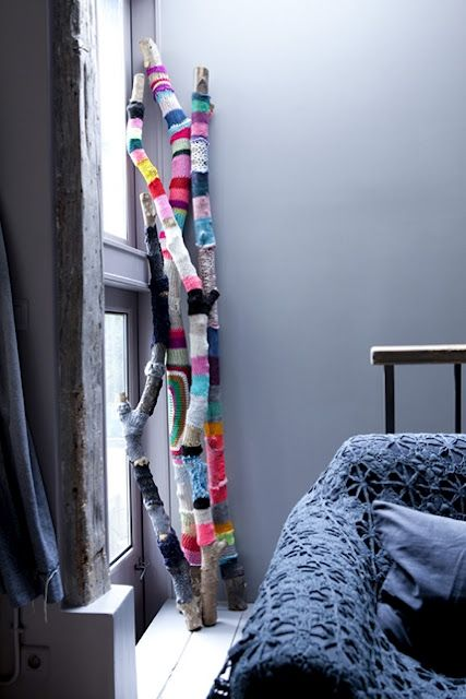 {branches habillées} wrap branches in various colors of yarn to add color to a space with a outside-in feel. #diyidea