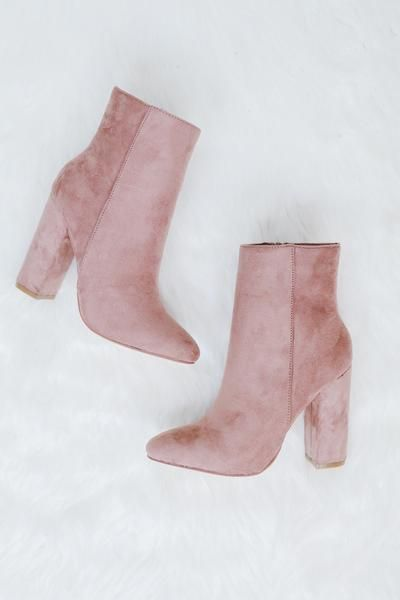 • Rose suede high ankle high heeled boot • Available in sizes 5.5 - 10 U.S. standard sizing • Clean with a damp cloth