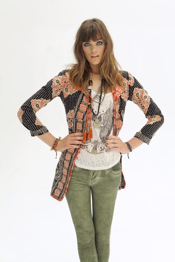 Stunning ethnic jacket paired with army green skinnies, printed tee & layered boho jewellery. Rapsodia.