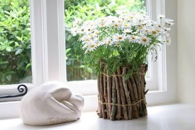 wrap twigs around a tin can to make this beautiful natural flower pot