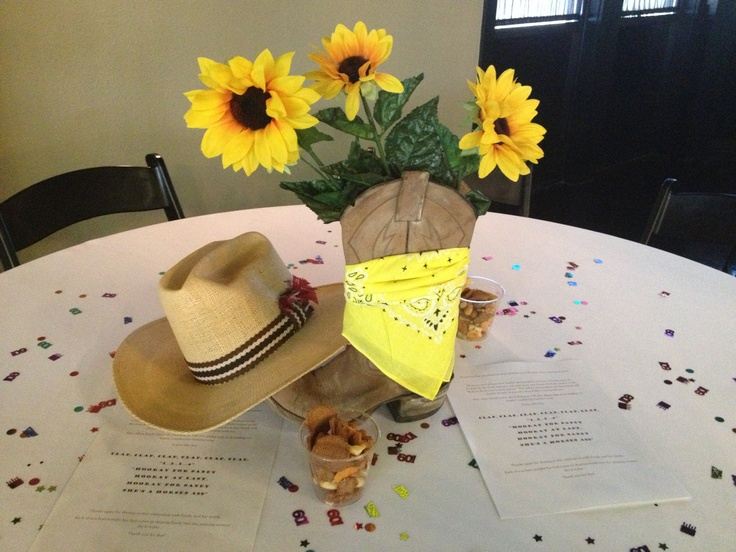 Cow cowgirl centerpiece. Old boot, sunflowers, bandana, and cowboy hat!