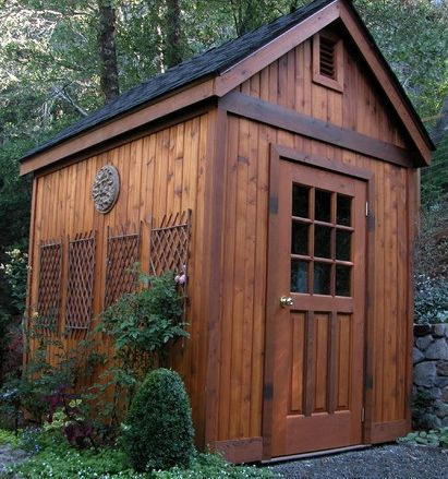 Mini trellises, a sculpture and a door with a window add character to this simple DIY shed kit.
