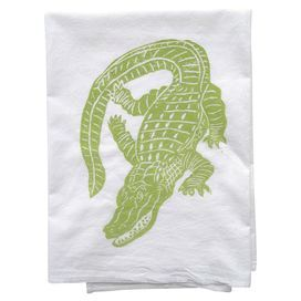 """Showcasing an alligator motif in green, this eye-catching dishtowel lends a touch of tropical charm to your kitchen decor.  Product: DishtowelConstruction Material: Flour sackColor: GreenFeatures: Alligator motif Dimensions: 30"""" x 30"""""""