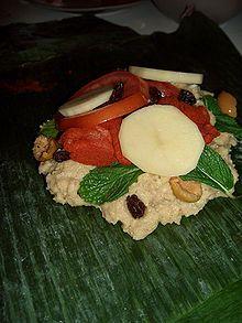 Nicaragua: Nacatamal - rice pork potato tomato mint olives raisins then rolled up