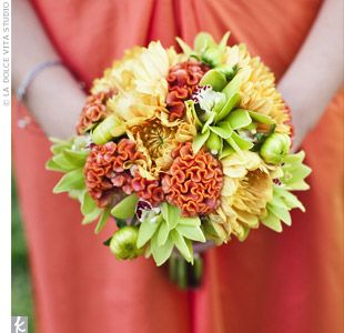Bouquets of orange dahlias, celosia and small green orchids.
