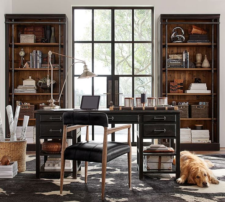 Reclaimed pine and metal bars pair neatly in this contemporary take on rustic library shelving.