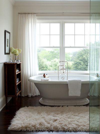 via Thriving Twenties   a thick, fluffy rug by a bathtub looks so cozy :)