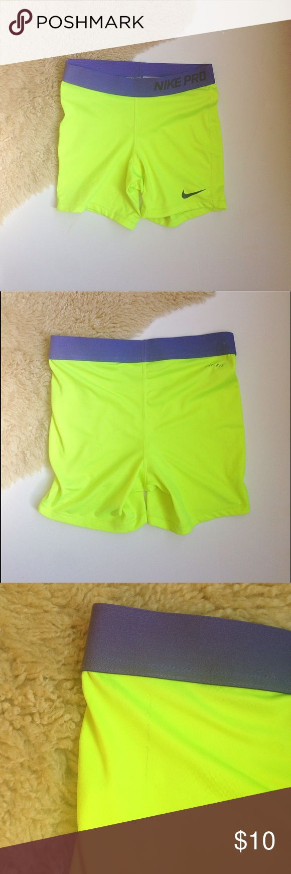 Nike Pro Shorts 🎉NEW ARRIVAL🎉 Yellow and Purple Nike Pro Shorts.  Girls Size Large- easily fit a Women's XS-S.   Small and very faint marks shown in pictures. Not noticeable when on, and can easily be removed with some spot cleaning. Reasonable offers welcome. Thanks💕  Items $5 and under are free with purchase of one more item.   15% off bundle purchases of 2+  Xx, ElyseeBoutique 🌙 Nike Shorts