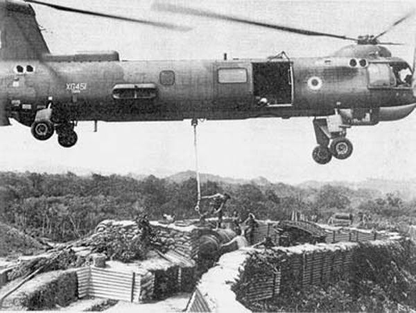 British Bristol 192 Belvedere Helicopter airlifting supplies during Borneo conflict