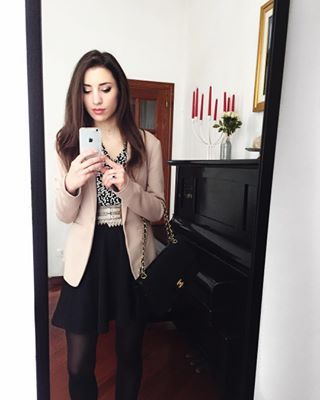 Italian fashion blogger Alessia takes a selfie with her outfit featuring a Chanel 2.55 . Spring outfit in Rome