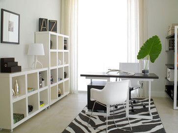 Simple home office in black and white - you can get similar square shelves at Ikea and put castors on them. That big green leaf really adds the perfect touch... nicely styled.
