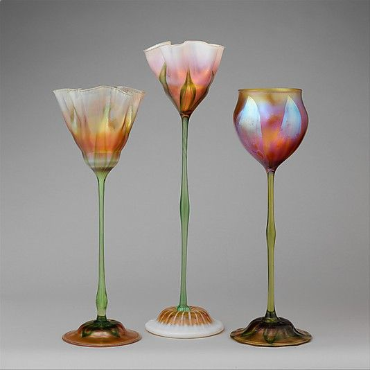 These vases are survivors. So delicate, made in 1900-1902 by Tiffany. Favrile Glass.