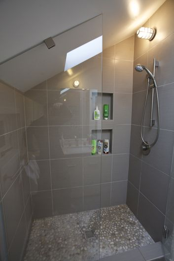 shower with a slanted ceiling | The glass shower door is sloped to match the slope of the ceiling